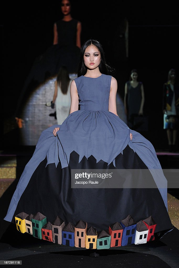 A model walks the runway at Mahshid Mahdian Fashion Show during the Mittelmoda Special Edition 2013 for Lectra on November 7, 2013 in Milan, Italy.