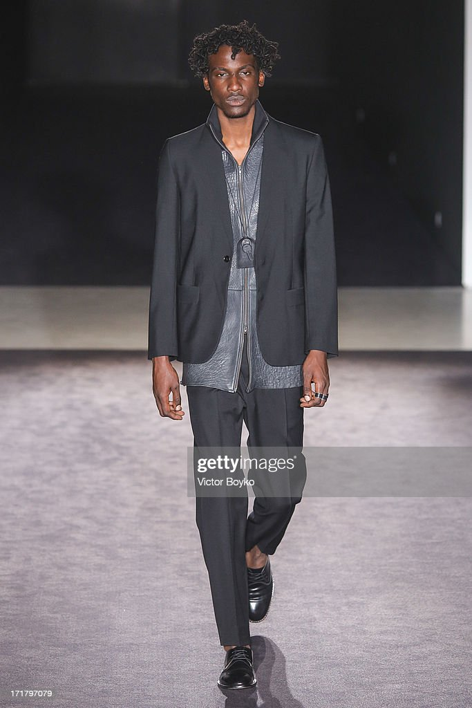 A model walks the runway at Maison Martin Margiela Menswear Spring/Summer 2014 Show As Part Of The Paris Fashion Week on June 28, 2013 in Paris, France.