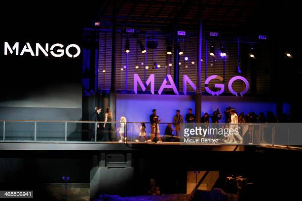 A model walks the runway at Mango's Autumm Winter 20142015 Collection during 080 Barcelona Fashion Week at the Born Centre Cultural on January 27...