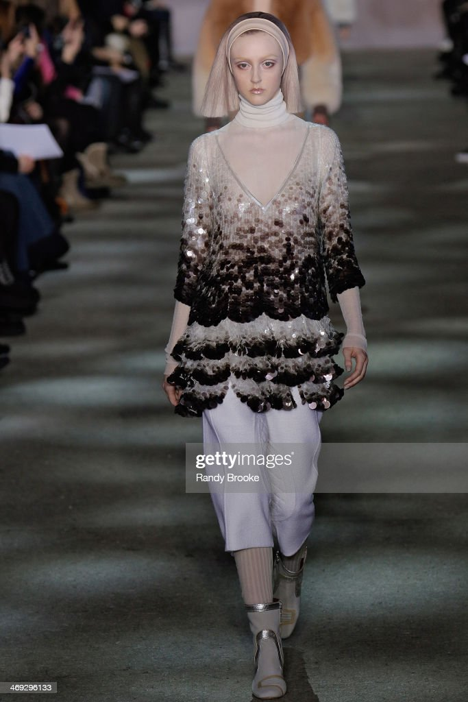 A model walks the runway at Marc Jacobs during Mercedes-Benz Fashion Week Fall 2014 at Lexington Avenue Armory on February 13, 2014 in New York City.
