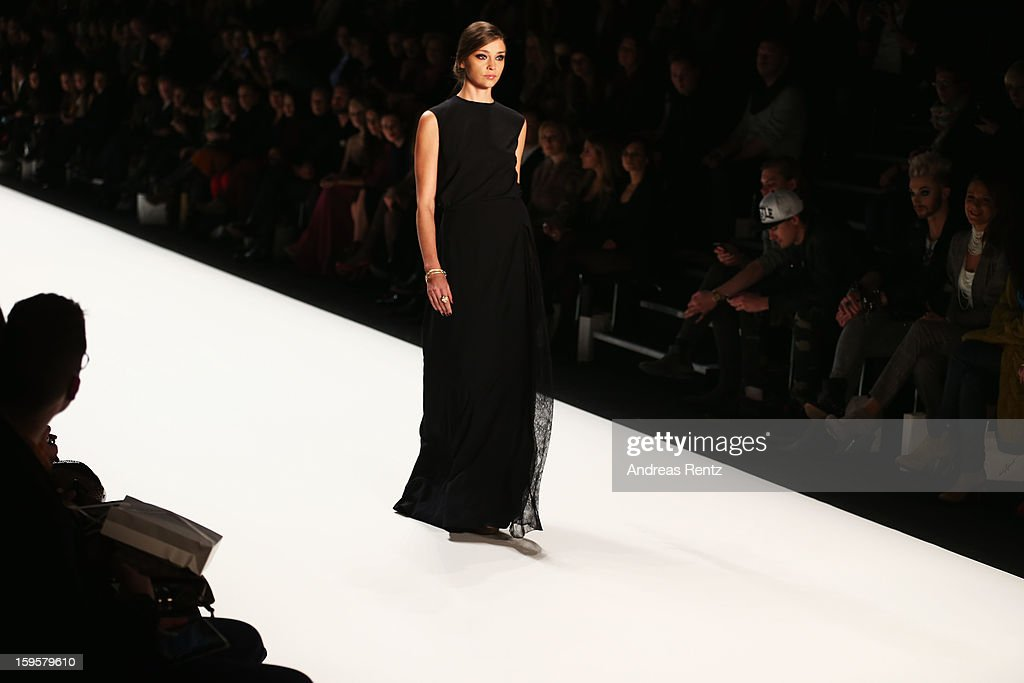 A model walks the runway at Mercedes-Benz Fashion Week Autumn/Winter 2013/14 at The Brandenburg Gate on January 16, 2013 in Berlin, Germany.