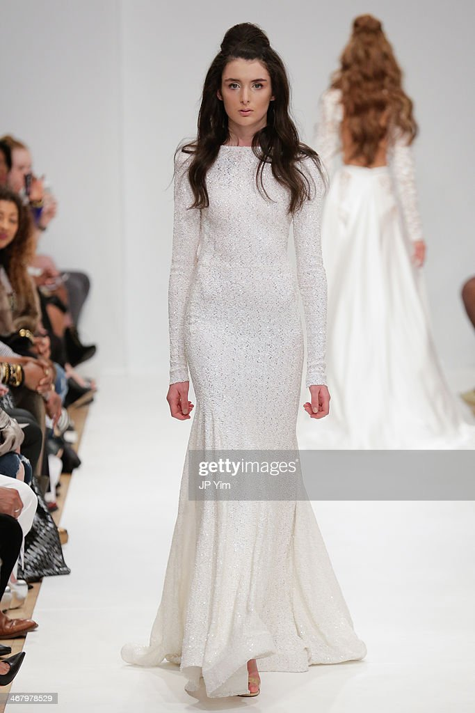 A model walks the runway at Michael Costello Fall 2014 Collection during Mercedes-Benz Fashion Week Fall 2014 at Helen Mills Event Space on February 8, 2014 in New York City.