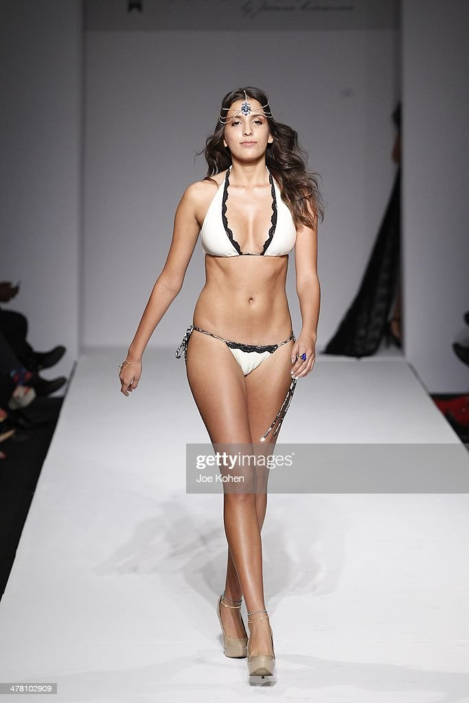 A model walks the runway at Miss Kinsman Swimwear fashion show during Style Fashion Week - Day 3 at L.A. Live Event Deck on March 11, 2014 in Los Angeles, California.