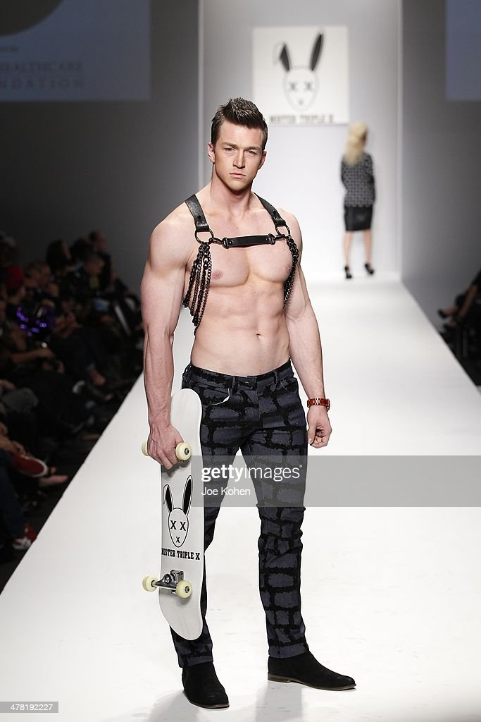 A model walks the runway at Mister Triple X fashion show during Style Fashion Week - Day 3 at L.A. Live Event Deck on March 11, 2014 in Los Angeles, California.