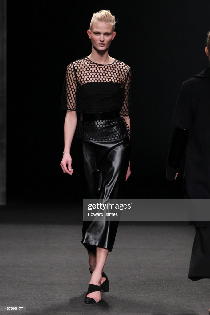 A model walks the runway at Monique Lhuillier during Mercedes-Benz Fashion Week Fall 2014 at The Theatre at Lincoln Center on February 8, 2014 in New York City.