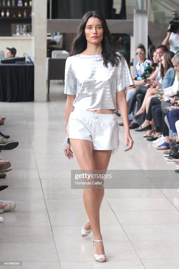 A model walks the runway at Pat Pats show during Sao Paulo Fashion Week Summer 2014/2015 at Parque Candido Portinari on April 1, 2014 in Sao Paulo, Brazil.