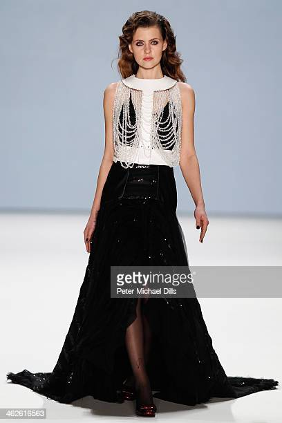 A model walks the runway at Rebekka Ruetz show during MercedesBenz Fashion Week Autumn/Winter 2014/15 at Brandenburg Gate on January 14 2014 in...