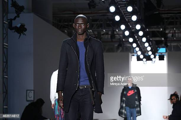 A model walks the runway at rehearsal before Public School runway show during MADE Fashion Week Fall 2015 at Studio 330 on February 15 2015 in New...
