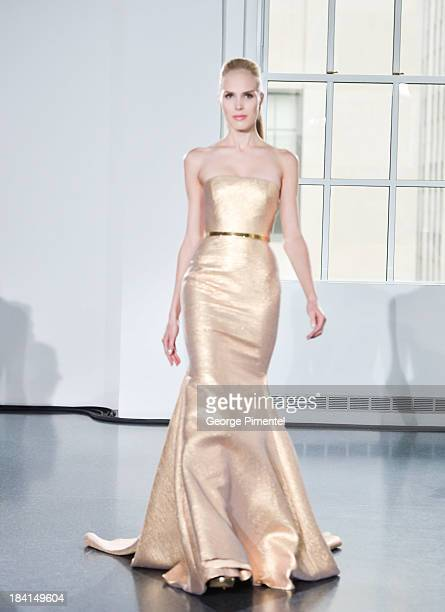 A model walks the runway at Romona Keveza RTW Spring 2014 during the Romona Keveza Fall 2014 Bridal collection presentation at 620 Loft Garden on...