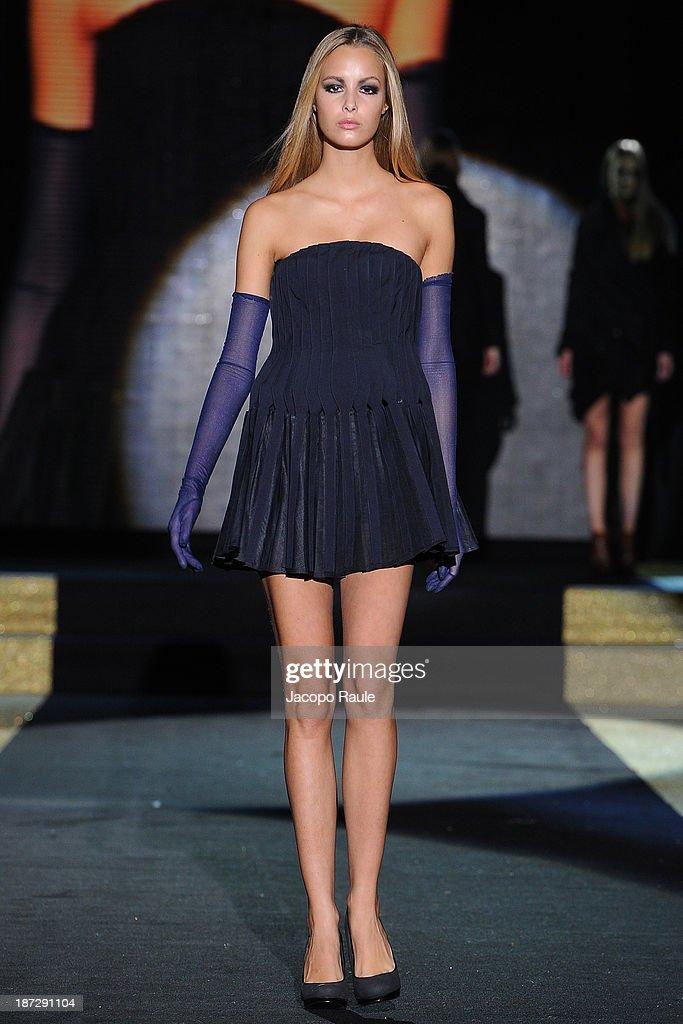 A model walks the runway at Ryuya Ohishi and Kazu Minakata Fashion Show during the Mittelmoda Special Edition 2013 for Lectra on November 7, 2013 in Milan, Italy.