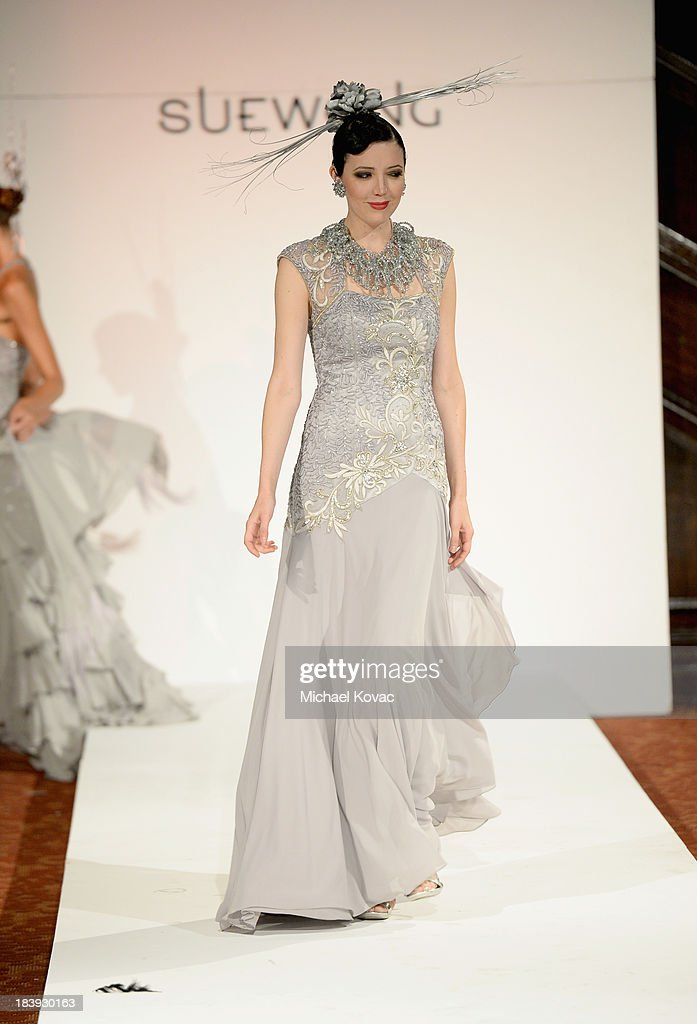 A model walks the runway at Sue Wong 'Jazz Babies' Spring 2014 Runway Show on October 9, 2013 in Los Angeles, California.