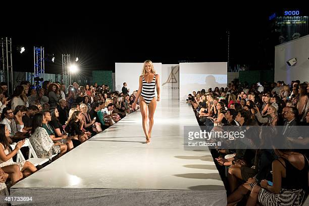 A model walks the runway at LA Swim Week Kick Off Event and Fashion Show at The London on July 23 2015 in West Hollywood California