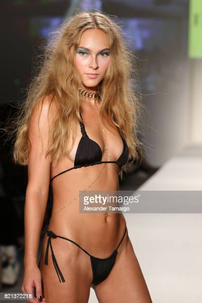 A model walks the runway at SWIMMIAMI INDAH 2018 Collection at SWIMMIAMI tent on July 23 2017 in Miami Beach Florida