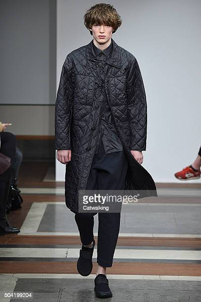 A model walks the runway at the 1205 Autumn Winter 2016 fashion show during London Menswear Fashion Week on January 8 2016 in London United Kingdom