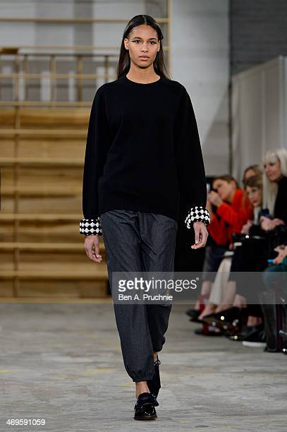 A model walks the runway at the 1205 show at London Fashion Week AW14 at School of Tropical Medicine on February 15 2014 in London England