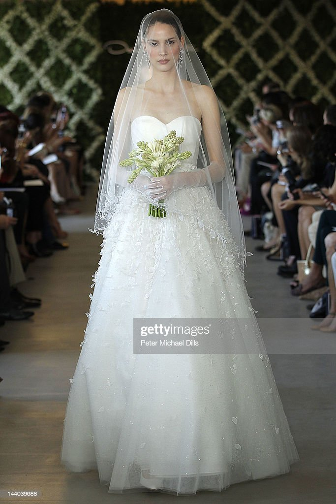 A model walks the runway at the 2013 Bridal Collection Oscar DeLa Renta show on April 16, 2012 in New York City.