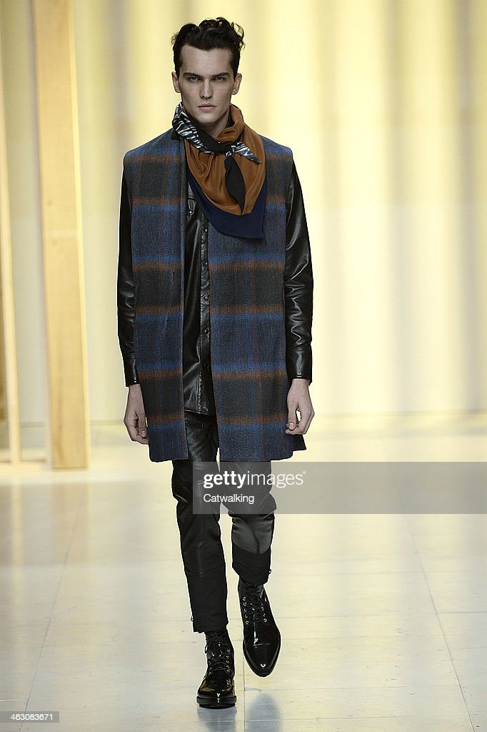 A model walks the runway at the 3.1 Phillip Lim Autumn Winter 2014 fashion show during Paris Menswear Fashion Week on January 16, 2014 in Paris, France.