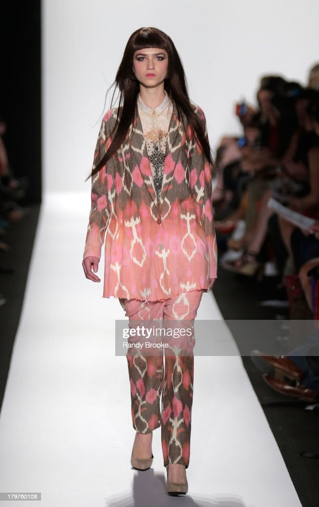 A model walks the runway at the Academy of Art University Spring 2014 Collections fashion show during Mercedes-Benz Fashion Week at Lincoln Center on September 6, 2013 in New York City.