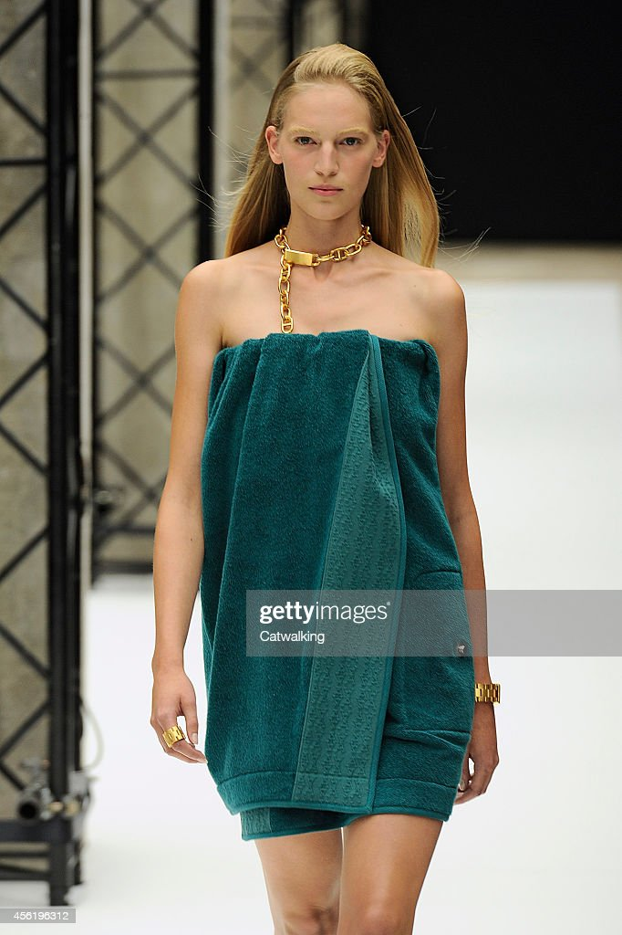 A model walks the runway at the Acne Studios Spring Summer 2015 fashion show during Paris Fashion Week on September 27 2014 in Paris France