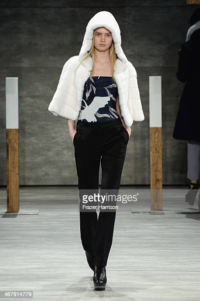 A model walks the runway at the Adeam fashion show during MercedesBenz Fashion Week Fall 2014 at Lincoln Center on February 8 2014 in New York City