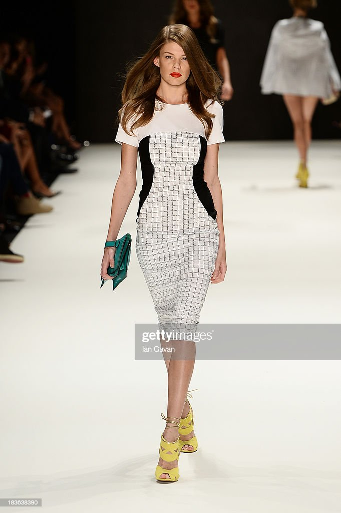A model walks the runway at the ADL & Cengiz Abazoglu show during Mercedes-Benz Fashion Week Istanbul s/s 2014 presented by American Express on October 8, 2013 in Istanbul, Turkey.