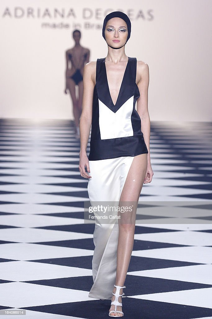 A model walks the runway at the Adriana Degreas during Sao Paulo Fashion Week Summer 2013/2014 on March 19 2013 in Sao Paulo Brazil