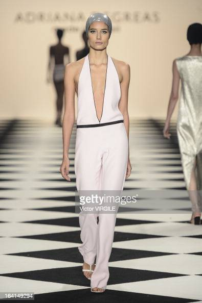 A model walks the runway at the Adriana Degreas during Sao Paulo Fashion Week Spring Summer 2013/2014 on March 19 2013 in Sao Paulo Brazil