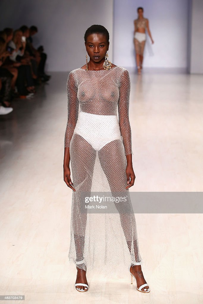 A model walks the runway at the Ae'lkemi show during Mercedes-Benz Fashion Week Australia 2014 at Carriageworks on April 10, 2014 in Sydney, Australia.