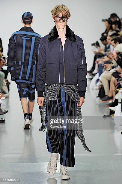 A model walks the runway at the Agi Sam Spring Summer 2016 fashion show during London Menswear Fashion Week on June 13 2015 in London United Kingdom