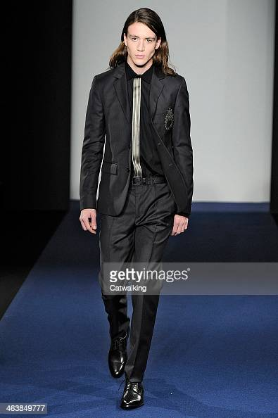 A model walks the runway at the Agnes B Autumn Winter 2014 fashion show during Paris Menswear Fashion Week on January 19 2014 in Paris France