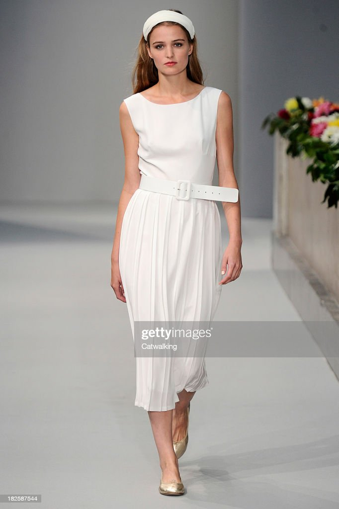 A model walks the runway at the Agnes B Spring Summer 2014 fashion show during Paris Fashion Week on October 1, 2013 in Paris, France.
