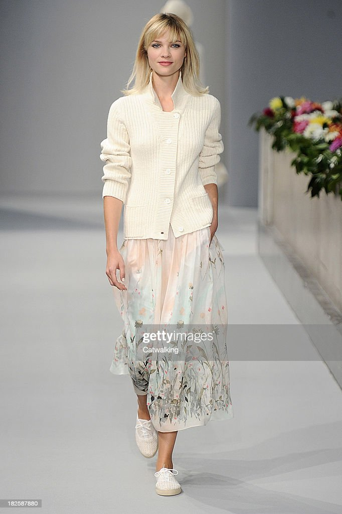 A model walks the runway at the Agnes B Spring Summer 2014 fashion show during Paris Fashion Week on October 1 2013 in Paris France