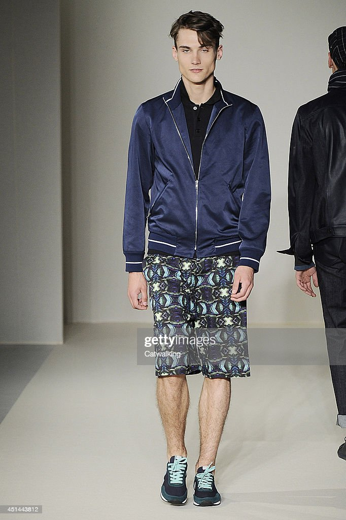 A model walks the runway at the Agnes b Spring Summer 2015 fashion show during Paris Menswear Fashion Week on June 29, 2014 in Paris, France.