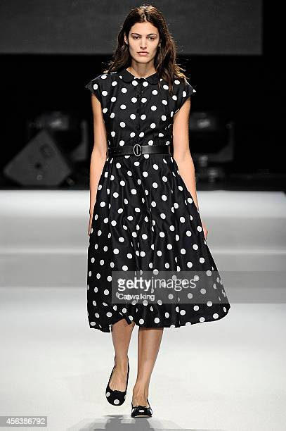 A model walks the runway at the Agnes B Spring Summer 2015 fashion show during Paris Fashion Week on September 30 2014 in Paris France
