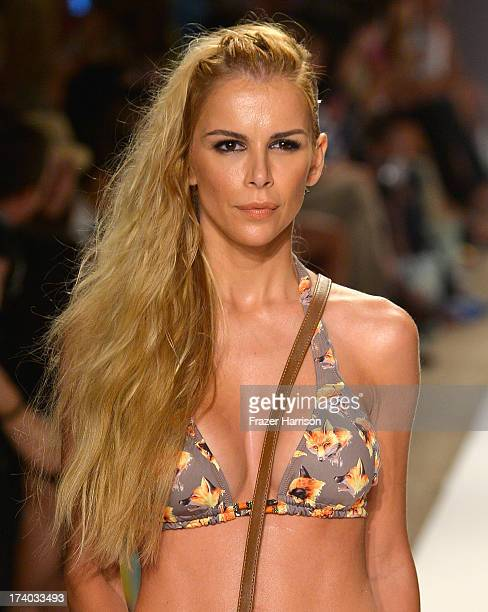 A model walks the runway at the Agua Bendita show with TRESemme during MercedesBenz Fashion Week Swim 2014 at the Raleigh on July 19 2013 in Miami...