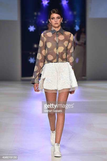 A model walks the runway at the Aje show during MB Presents Australian Style show during MercedesBenz Fashion Festival Sydney at Sydney Town Hall on...