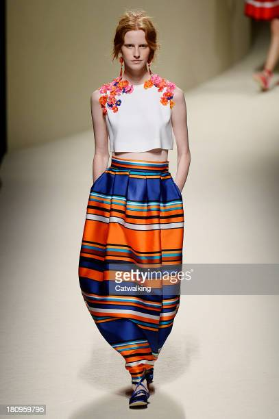 A model walks the runway at the Alberta Ferreti Spring Summer 2014 fashion show during Milan Fashion Week on September 18 2013 in Milan Italy