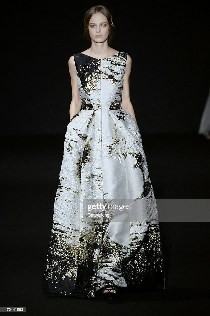 A model walks the runway at the Alberta Ferretti Autumn Winter 2014 fashion show during Milan Fashion Week on February 19 2014 in Milan Italy