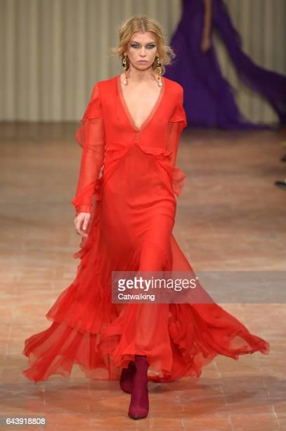 A model walks the runway at the Alberta Ferretti Autumn Winter 2017 fashion show during Milan Fashion Week on February 22 2017 in Milan Italy