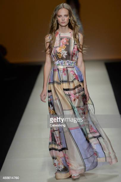A model walks the runway at the Alberta Ferretti Spring Summer 2015 fashion show during Milan Fashion Week on September 17 2014 in Milan Italy