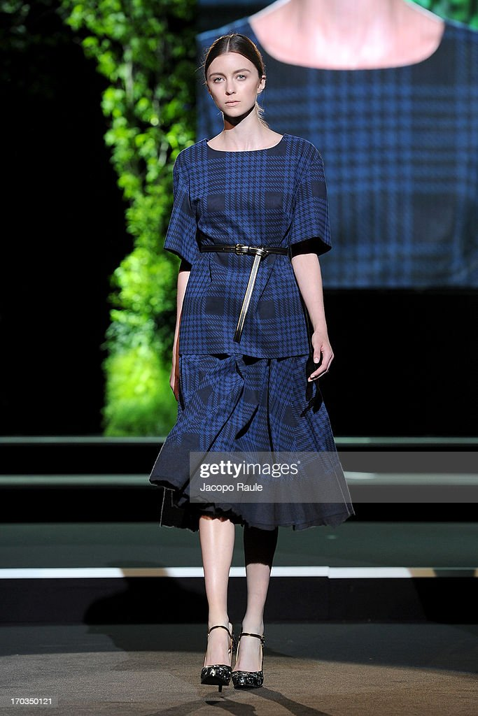 A model walks the runway at the Alcantara featuring Aquilano.Rimondi fashion show during Glamour Live Show on June 11, 2013 in Milan, Italy.