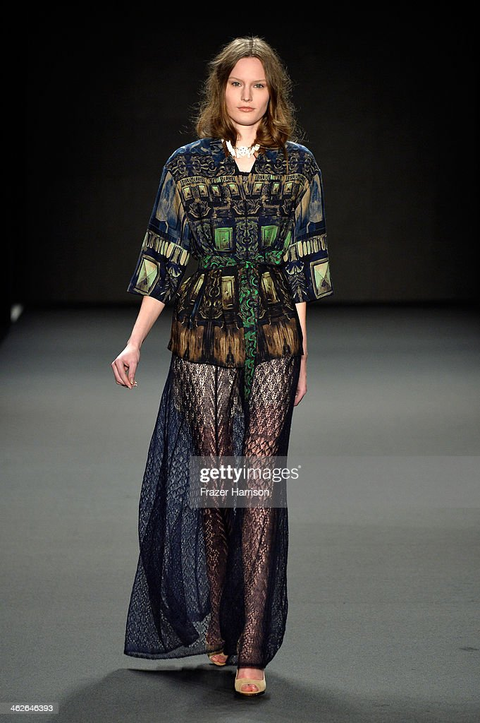 A model walks the runway at the Alena Akhmadullina - presented by Mercedes-Benz and ELLE Backstage show during Mercedes-Benz Fashion Week Autumn/Winter 2014/15 at Brandenburg Gate on January 14, 2014 in Berlin, Germany.