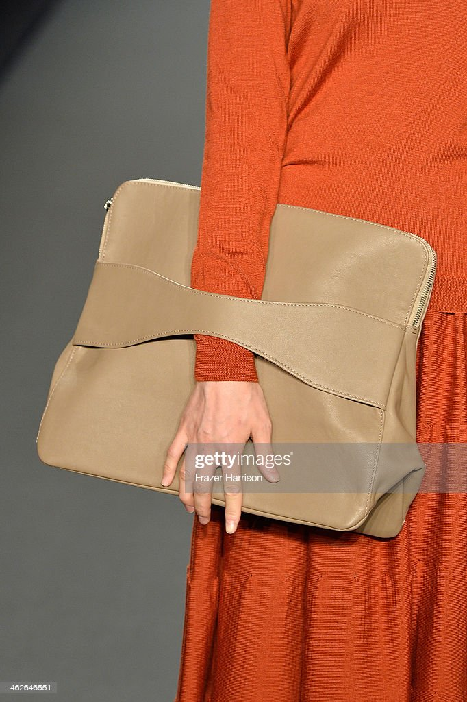 A model (bag detail) walks the runway at the Alena Akhmadullina - presented by Mercedes-Benz and ELLE Backstage show during Mercedes-Benz Fashion Week Autumn/Winter 2014/15 at Brandenburg Gate on January 14, 2014 in Berlin, Germany.
