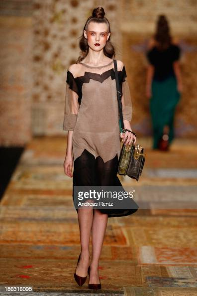 A model walks the runway at the Alena Akhmadullina show during MercedesBenz Fashion Week Russia S/S 2014 on October 30 2013 in Moscow Russia
