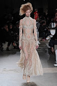 A model walks the runway at the Alexander McQueen Autumn Winter 2015 fashion show during Paris Fashion Week on March 10 2015 in Paris France