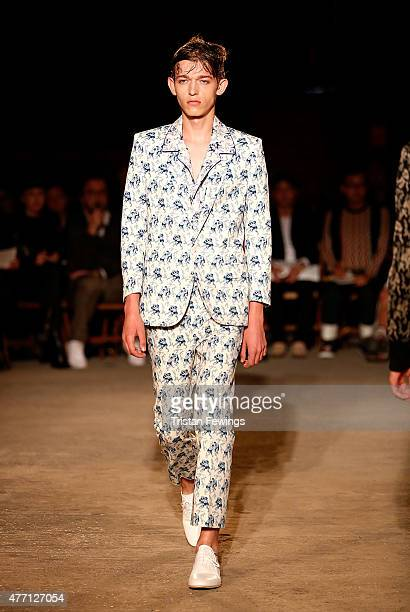 A model walks the runway at the Alexander McQueen show during The London Collections Men SS16 at The Arches on June 14 2015 in London England
