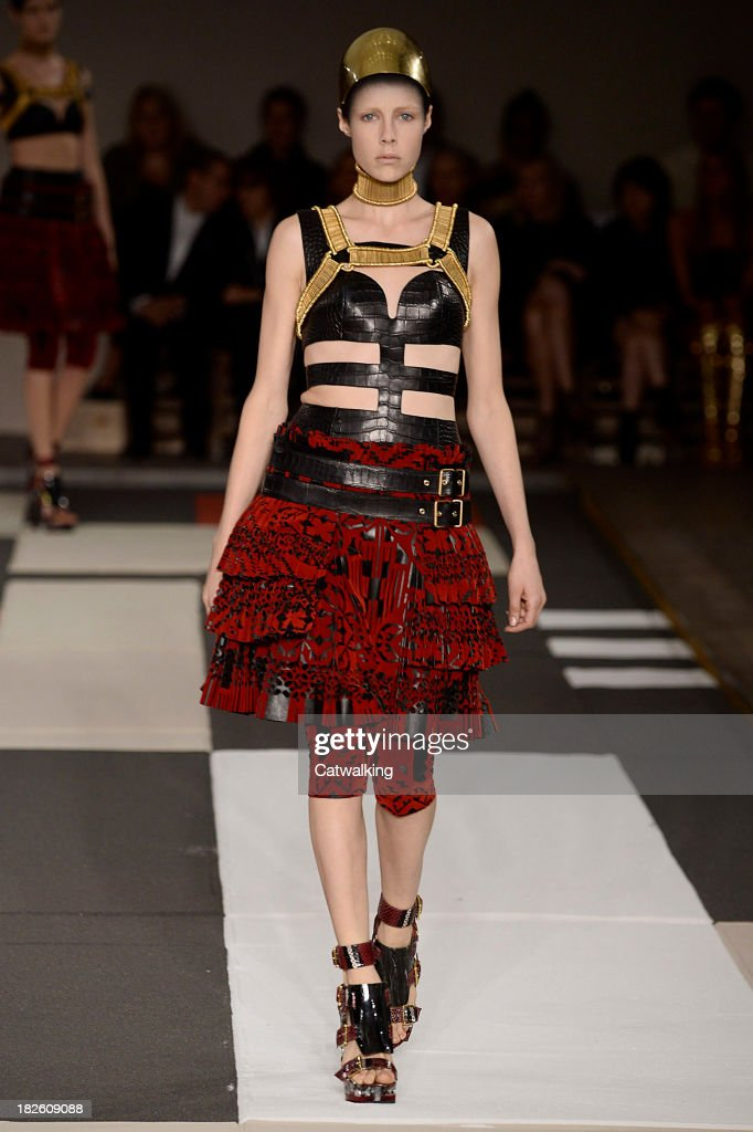 A model walks the runway at the Alexander McQueen Spring Summer 2014 fashion show during Paris Fashion Week on October 1, 2013 in Paris, France.