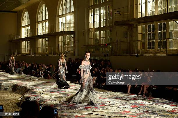 A model walks the runway at the Alexander McQueen Spring Summer 2017 fashion show during Paris Fashion Week on October 3 2016 in Paris France