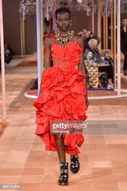 A model walks the runway at the Alexander McQueen Spring Summer 2018 fashion show during Paris Fashion Week on October 2 2017 in Paris France