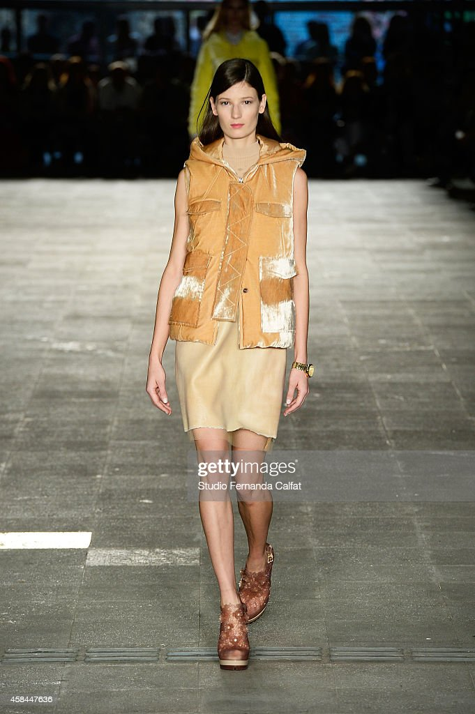 A model walks the runway at the Alexandre Herchcovitch fashion show during Sao Paulo Fashion Week Winter 2015 at the Praca das Artes on November 5...